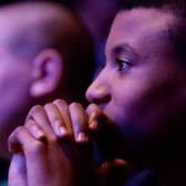 Thoughtful young man listening to classical music concert