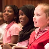 Young people enjoying classical music concert