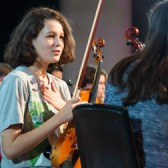 Young women holding violins